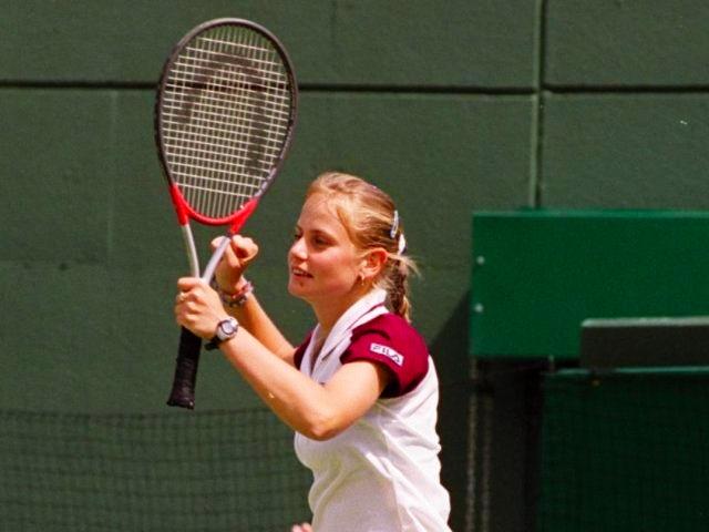 Jelena Dokic celebrates beating Martina Hingis.