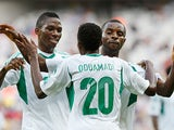 Nigeria's Nnamdi Oduamadi is congratulated by team mates after scoring his team's third against Tahiti in the Confederations Cup on June 17, 2013