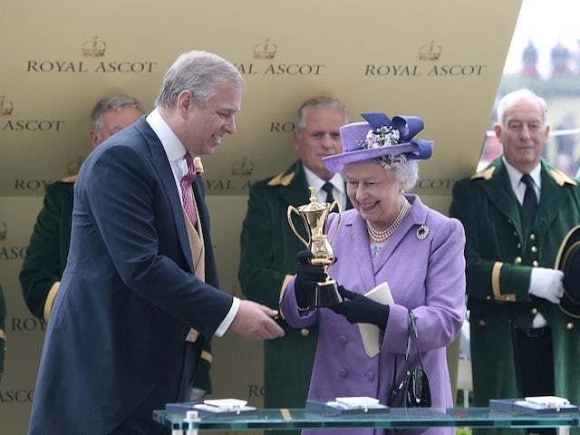 The Queen receives the Gold Cup after her horse Estimate won at Ascot on June 20, 2013