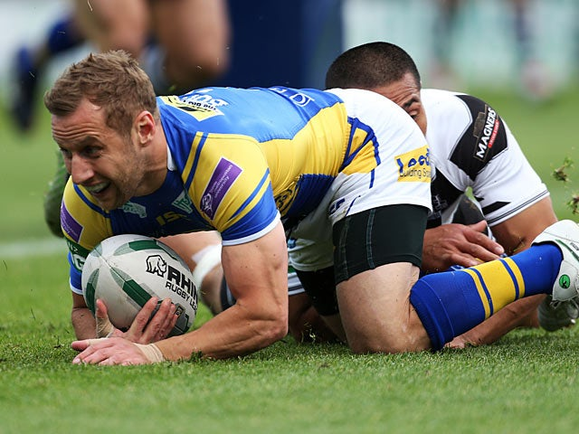 Leeds Rhinos' Rob Burrows scores a try against Widnes Vikings on June 17, 2013