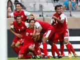 Tahiti's Jonathan Tehau is mobbed by team mates after scoring against Nigeria in the Confederations Cup on June 17, 2013
