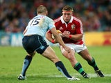 British and Irish Lions' Tom Youngs takes on Waratahs Drew Mitchell during the British and Irish Lions Tour match on June 15, 2013