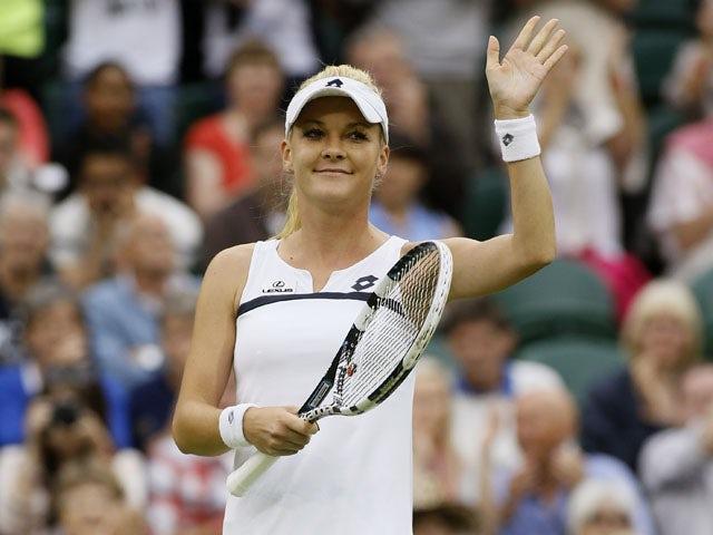 Agnieszka Radwanska of Poland celebrates after beating Mathilde Johansson of France during their Women's second round singles match on June 27, 2013