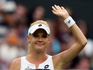 Agnieszka Radwanska celebrates a win at Wimbledon on June 28, 2013