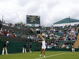Ana Ivanovic serves against Virginie Razzano at Wimbledon on June 24, 2013