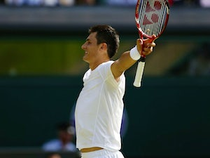 Result: Tomic moves into round four