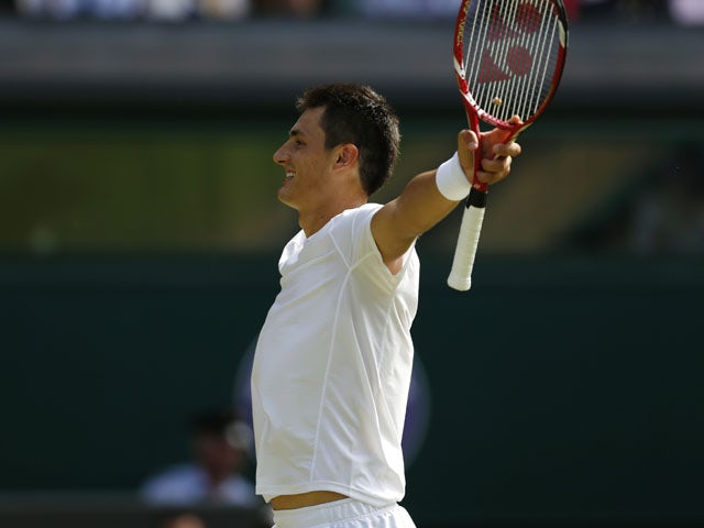 Bernard Tomic of Australia reacts after beating Richard Gasquet of France during their Men's singles match at the Wimbledon Tennis Championships on June 29, 2013
