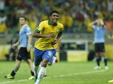 Brazil's Paulinho celebrates scoring his side's 2nd goal during the soccer Confederations Cup semifinal match between Brazil and Uruguay on June 26, 2013