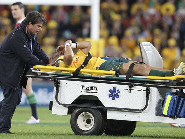 Australia's Christian Lealiifano leaves the field after he was injured during the first minute of the match against the British and Irish Lions on June 22, 2013