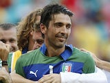 A teammate embraces Italy's Gianluigi Buffon after he saved the decisive shot during the penalty shoot-out at the soccer Confederations Cup third-place match against Uruguay on June 30, 2013