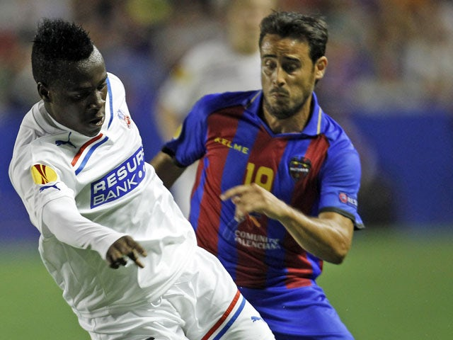 Helsingborg's David Accam is pursued by Levante's Vicente Iborra during the side's Europa League clash on September 20, 2012