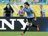 Uruguay's Edinson Cavani celebrates after scoring his second goal against Italy during the Confederations Cup on June 30, 2013