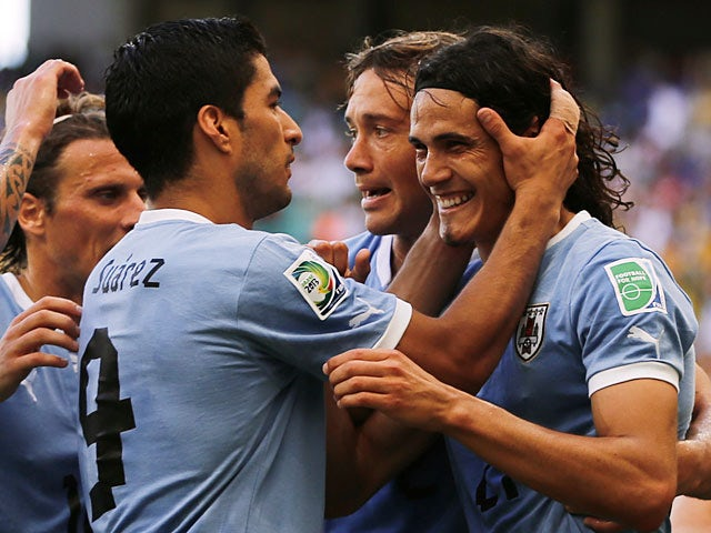 Uruguay's Edinson Cavani is congratulated by team mates after scoring his first goal against Italy during the Confederations Cup on June 30, 2013