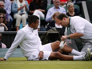 Injured Tsonga forced to retire at Wimbledon