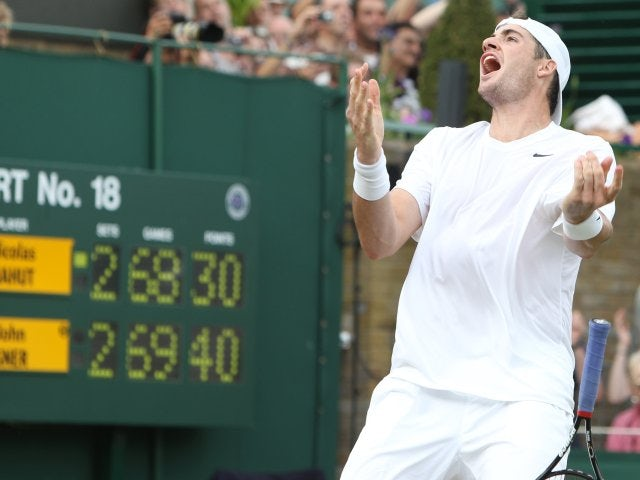 John Isner celebrates beating Nicolas Mahut at Wimbledon.