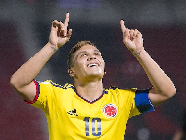 Result: Colombia top group with win