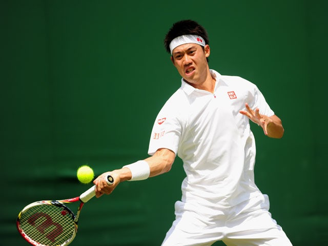 Japan's Kei Nishikori in action against Australia's Matthew Ebden during the first round of Wimbledon on June 25, 2013