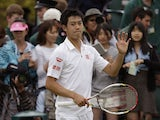Kei Nishikori of Japan reacts after beating Leonardo Mayer of Argentina during their Men's second round singles match on June 27, 2013