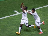 Ghana's Kennedy Ashia celebrates with team mate Clifford Aboagye after scoring his team's fourth goal against USA during their U20 World Cup match on June 27, 2013