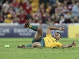 Kurtley Beale of Australia slips and falls as he fails to kick the final penalty which would have given Australia victory against the British and Irish Lions during the first rugby test match on June 22, 2013