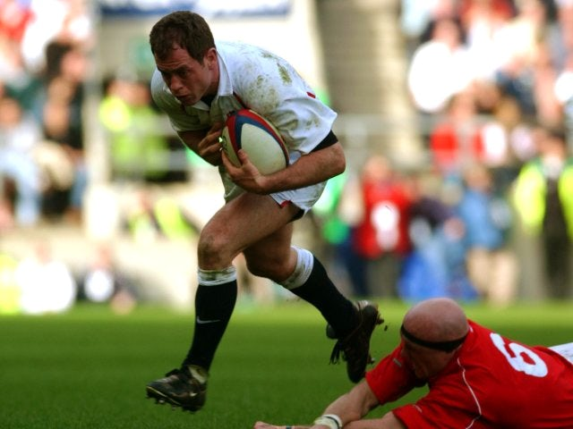 Kyran Bracken skips beyond a tackle while playing for England against Wales.