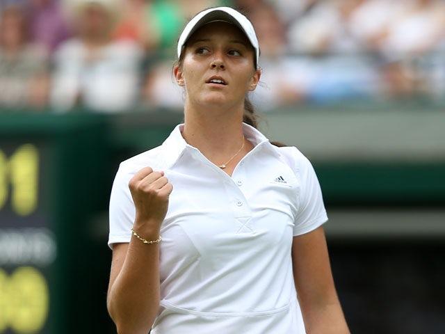 Great Britain's Laura Robson celebrates winning the first set against Russia's Maria Kirilenko on June 25, 2013