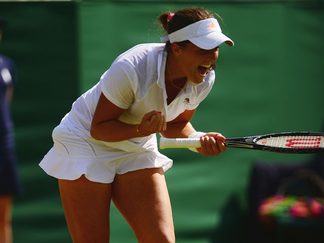 Great Britain's Laura Robson celebrates defeating New Zealand's Marina Erakovic in their third round match at Wimbledon on June 27, 2013