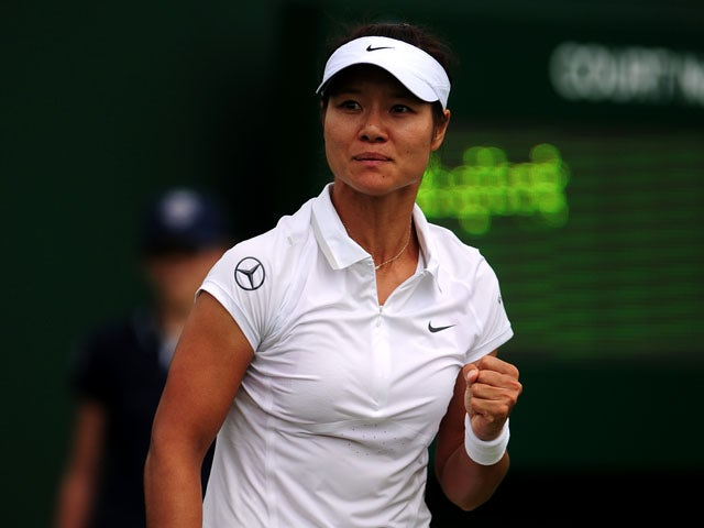 China's Li Na celebrates against Netherland's Michaella Krajicek during the first round match at Wimbledon on June 25, 2013