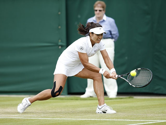 China's Li Na in action against Romania's Simona Halep during day four of the Wimbledon Championships on June 27, 2013
