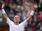 Australia's Lleyton Hewitt celebrates defeating Switzerland's Stanislas Wawrinka during their first round match at Wimbledon on June 24, 2013
