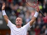 Australia's Lleyton Hewitt celebrates defeating Switzerland's Stanislas Wawrinka during their first round match at Wimbledon on June 24, 2013