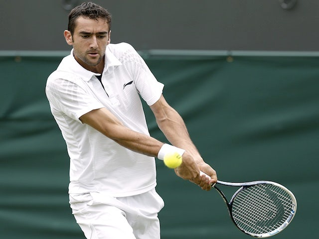 Marin Cilic in action against Marcos Baghdatis on June 24, 2013