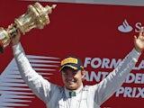 Nico Rosberg celebrates on the podium after winning the British Grand Prix at Silverstone on June 30, 2013