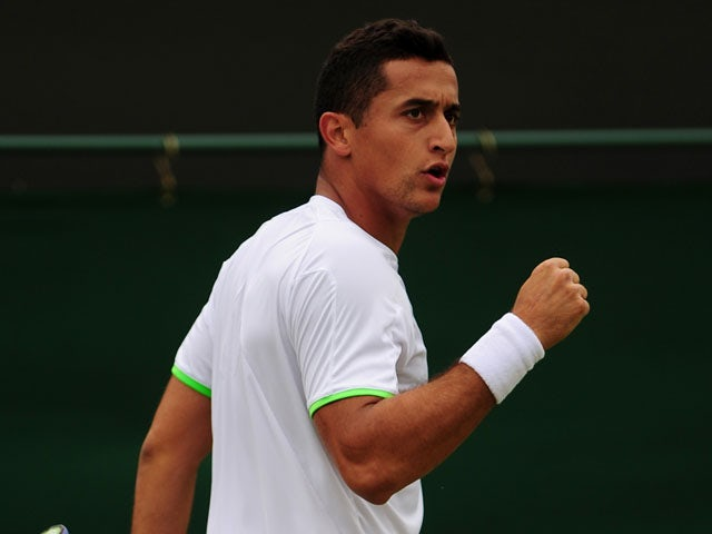 Spain's Nicolas Almagro celebrates a point against France's Guillaume Rufin during their second round singles match on June 26, 2013