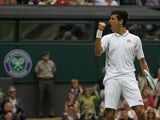 Novak Djokovic of Serbia reacts after winning a set against Florian Mayer of Germany during their Men's first round singles match on June 25, 2013