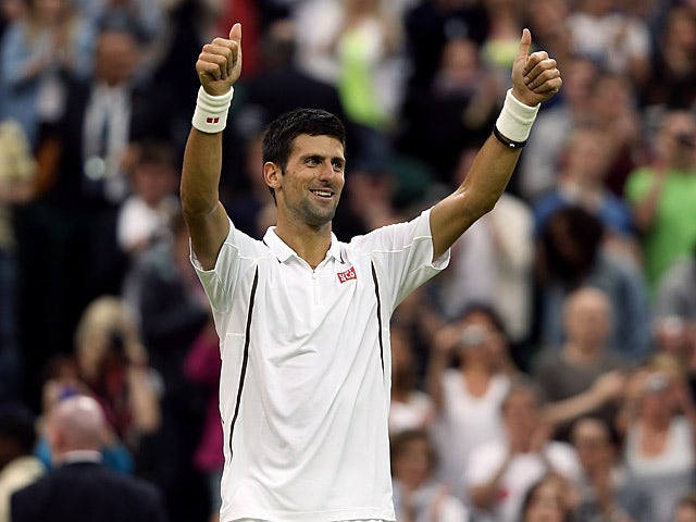Novak Djokovic celebrates after beating Bobby Reynolds during the second round at Wimbledon on June 27, 2013