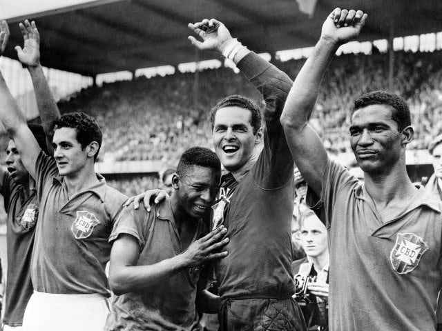 An emotional Pele celebrates winning the 1958 World Cup with his teammates.