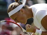 Petra Kvitova of the Czech Republic celebrates after beating Ekaterina Makarova of Russia in their Women's singles match on June 29, 2013