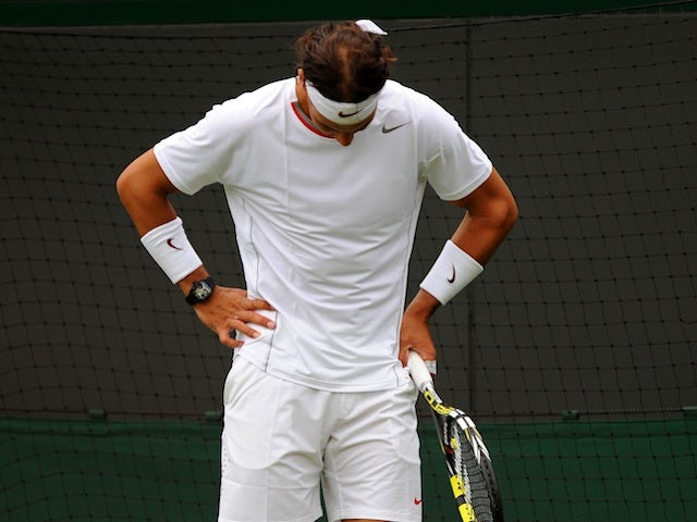 Rafa Nadal stands during his defeat to Steve Darcis on June 24, 2013