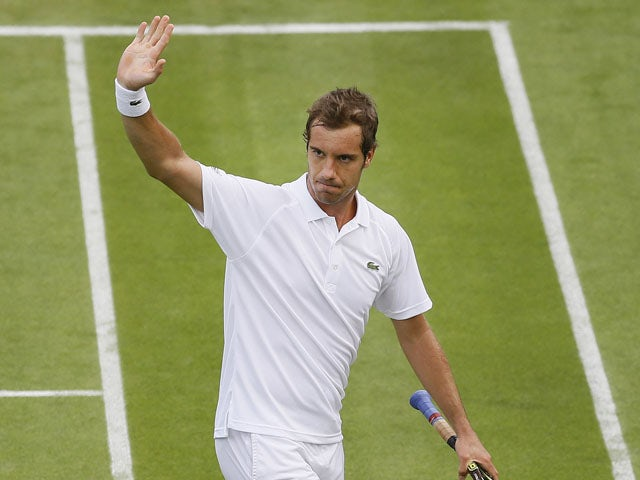 Richard Gasquet of France gestures to the public after defeating Marcel Granollers of Spain in their Men's first round singles match on June 25, 2013