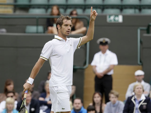 Richard Gasquet of France contests a point as he plays Go Soeda of Japan in their Men's second round singles match on June 27, 2013