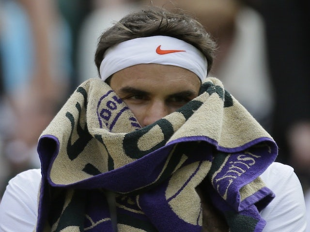 Roger Federer sits during his game with Sergiy Stakhovsky on June 26, 2013