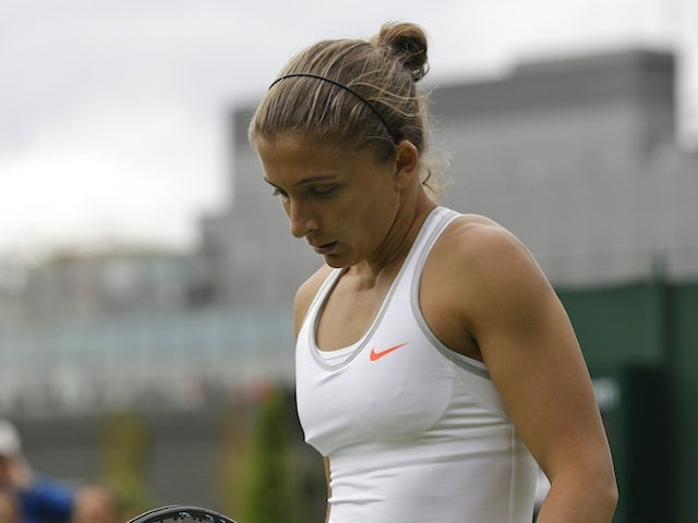 Sara Errani walks to her seat during her first round loss to Monica Puig on June 24, 2013
