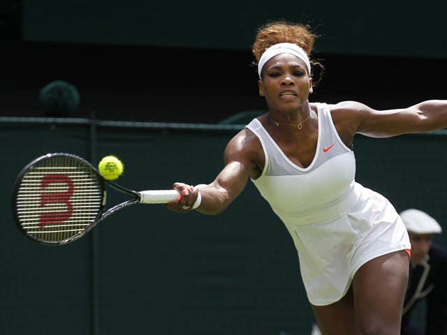 Serena Williams of the United States plays a return to Mandy Minella of Luxembourg during their Women's first round singles match on June 25, 2013