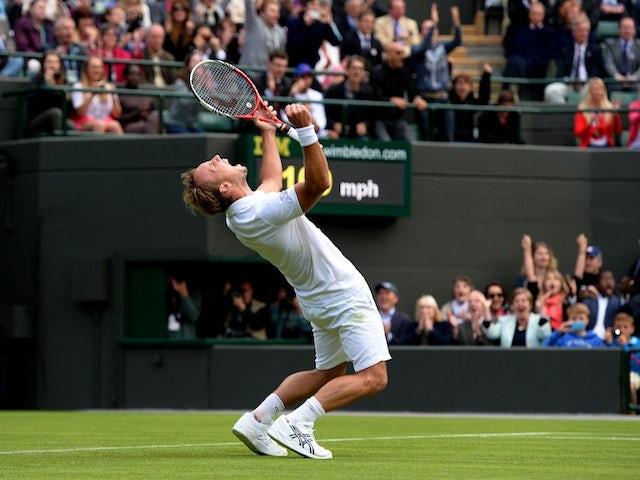 Steve Darcis celebrates beating Rafa Nadal at Wimbledon on June 24, 2013