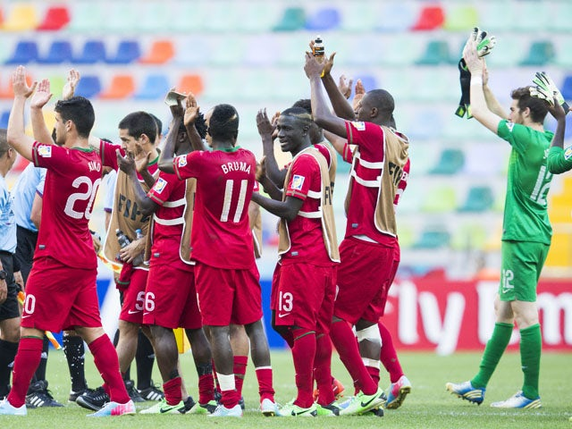 Players of the Portuguese team celebrate after the Under-20 World Cup win over Cuba on June 27, 2013