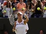Agnieszka Radwanska waves to the crowd as she celebrates her win over Tsvetana Pironkova during their Wimbledon match on July 1, 2013