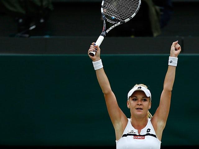 Agnieszka Radwanska celebrates moments after beating Li Na during their Wimbledon quarter final match on July 2, 2013