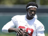 San Francisco 49ers linebacker Aldon Smith looks on during NFL football practice on May 22, 2013