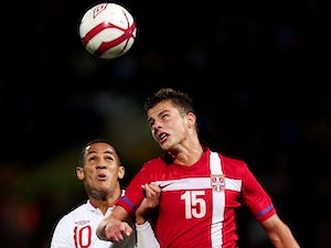 England's Tom Ince battles for the ball with Serbia's Aleksandar Pantic during a Under 21 match on October 12, 2012